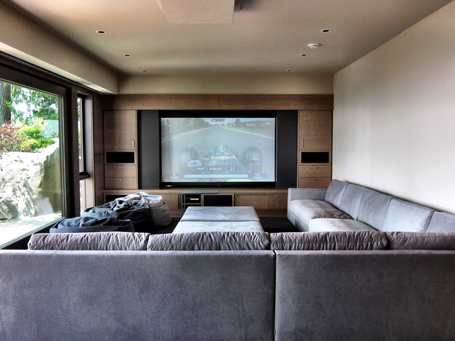 Contemporary Home Theater by Gaile Guevara