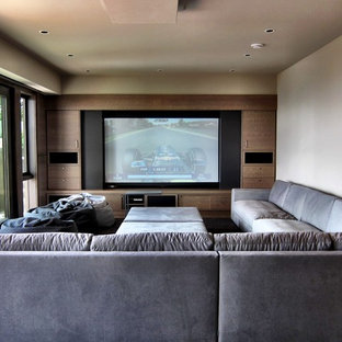 This is an example of a contemporary home cinema in Vancouver.