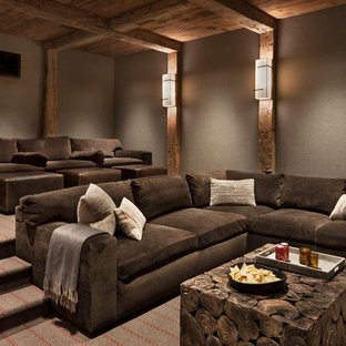 Inspiration for a large rustic enclosed home cinema in Other with grey walls, carpet and grey floors.