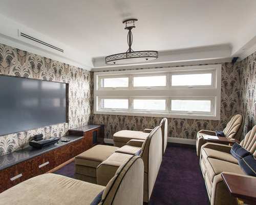 This is an example of a traditional enclosed home theatre in Other with multi-coloured walls, carpet and purple floor.
