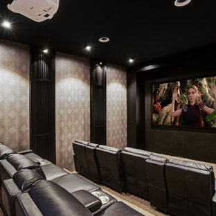 Inspiration for a large contemporary home theatre in Central Coast with black walls, carpet, a projector screen and beige floor.