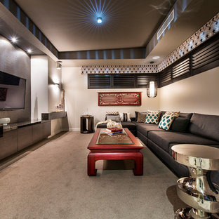 This is an example of a mid-sized eclectic enclosed home theatre in Perth with beige walls, carpet, a built-in media wall and grey floor.