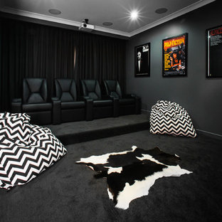 Inspiration for a contemporary enclosed home theatre in Brisbane with black walls, carpet and black floor.