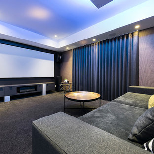 Inspiration for a contemporary enclosed home theatre in Perth with multi-coloured walls, carpet, a projector screen and grey floor.