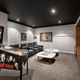 Photo Of A Contemporary Enclosed Home Theatre In Perth With Grey Walls,  Carpet, A
