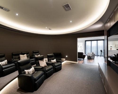photo of a contemporary enclosed home theatre in melbourne with brown walls carpet a - Home Theater Room Design Ideas