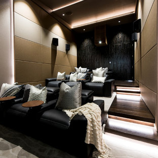 This is an example of a large contemporary enclosed home theatre in Sunshine Coast with beige walls, carpet and beige floor.