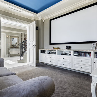 This is an example of a traditional enclosed home theatre in Sydney with grey walls, carpet, a projector screen and grey floor.