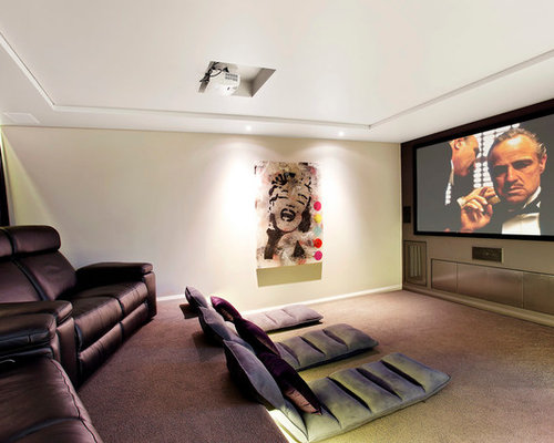 Example Of A Trendy Enclosed Carpeted Home Theater Design In Sydney With  Gray Walls And A