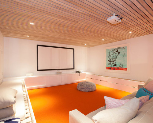 This Is An Example Of A Mid Sized Contemporary Enclosed Home Theatre In  Sydney With