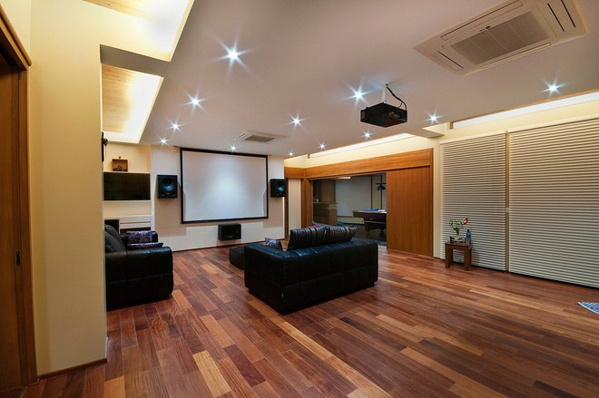 Contemporary Home Theater by Billimoria & Associates