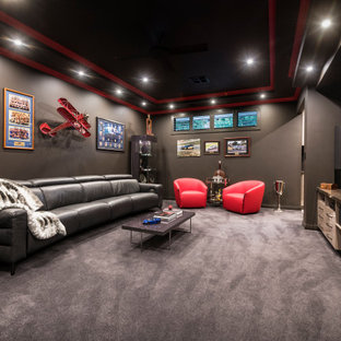 Design ideas for a large contemporary enclosed home theatre in Perth with brown walls, carpet, a wall-mounted tv and grey floor.