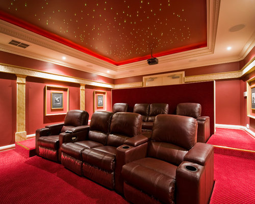 large traditional enclosed home theatre in perth with red walls carpet and a projector screen - Home Theatre Design Ideas