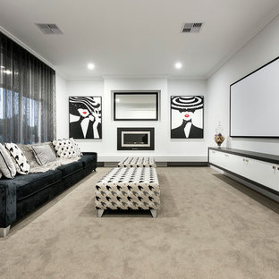 Mid-sized contemporary open concept home theatre in Perth with white walls, carpet and a projector screen.