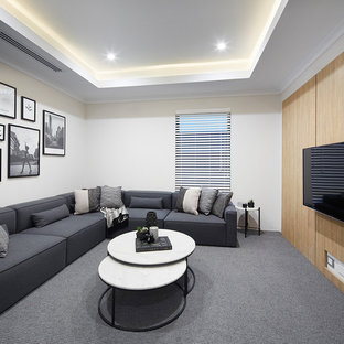 Inspiration for a contemporary enclosed home theatre in Perth with white walls, carpet, a wall-mounted tv and grey floor.