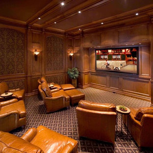 Traditional enclosed home theatre in Raleigh with brown walls, carpet, a wall-mounted tv and brown floor.