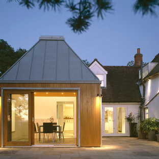 Photo of a contemporary exterior in Kent with a hip roof.