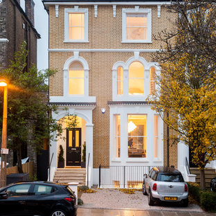 Photo of a medium sized traditional brick terraced house in London with three or more floors.