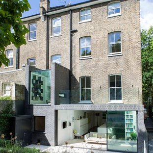 This is an example of a contemporary brick exterior in London with three or more floors.