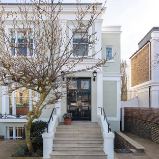 Inspiration for a green traditional two floor detached house in London with a flat roof.