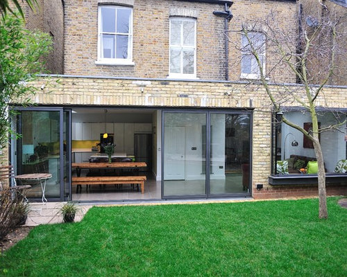 Mid-sized brick flat roof photo in London & Parapet Roof | Houzz memphite.com