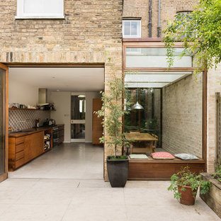 Medium sized and beige contemporary brick terraced house in London.