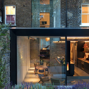 Photo of a contemporary brick terraced house in London with three or more floors.