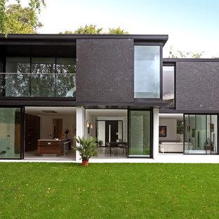 Idee per la facciata di una casa moderna con tetto piano