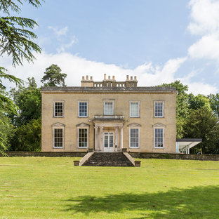 Inspiration for a large classic two floor detached house in Kent with a flat roof.