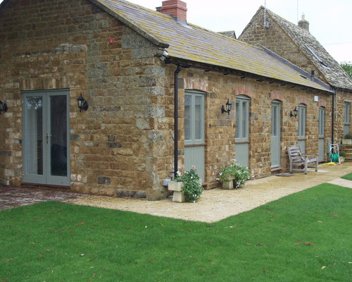 Example Of A Mountain Style Stone Exterior Home Design In Oxfordshire