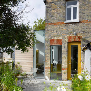 Photo of a medium sized contemporary two floor house exterior in London with mixed cladding.