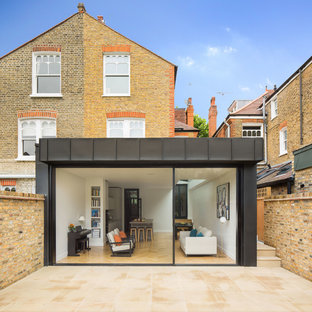 Medium sized and beige contemporary semi-detached house in London with three or more floors and mixed cladding.