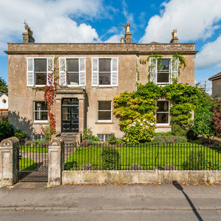 This is an example of a large and brown classic two floor detached house in Other with a flat roof.