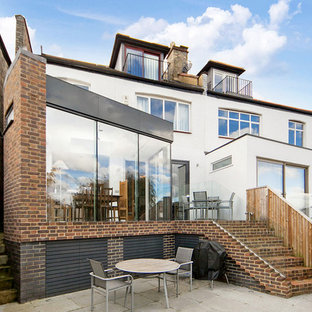 Design ideas for a medium sized and white contemporary semi-detached house in London with three floors and mixed cladding.