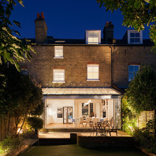 Design ideas for a contemporary brick exterior in London with three or more floors.