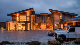 Contemporary house exterior: stacked stone, oak boarding