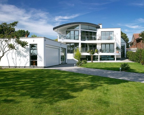 Photo Of A White Contemporary Detached House In Dorset With Three Or More  Floors.
