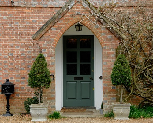 Example Of A Classic Red Brick Exterior Home Design In Kent
