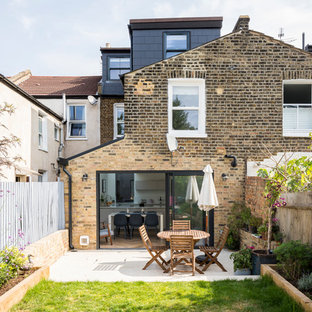 Inspiration for a brown contemporary brick detached house in London with three or more floors and a pitched roof.