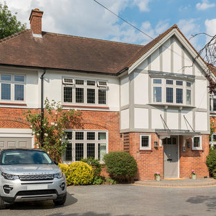 Inspiration for a large and multi-coloured traditional two floor detached house in Surrey with mixed cladding, a tiled roof and a hip roof.