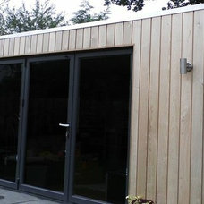 Contemporary Exterior by Links Construction Ltd