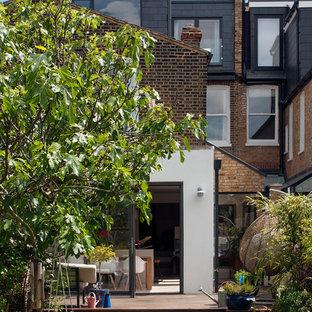Inspiration för ett vintage brunt radhus, med tre eller fler plan, blandad fasad, platt tak och tak i shingel
