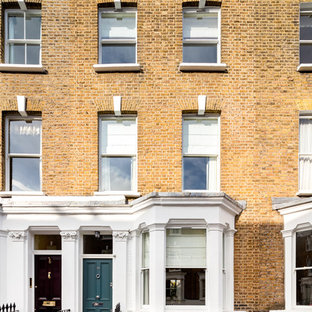 Mid-sized ornate three-story brick townhouse exterior photo in London