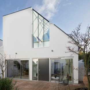 Design ideas for a medium sized and white contemporary two floor detached house in London.