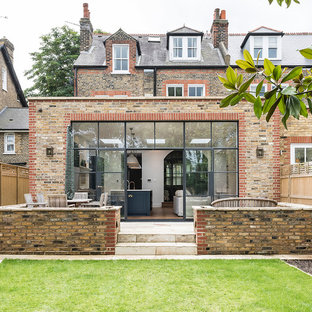 Large transitional three-storey beige exterior in London.
