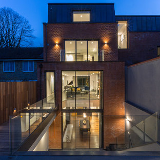 Mid-sized trendy red three-story brick exterior home photo in London