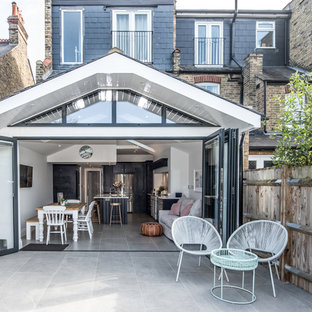 Mid-sized danish white one-story exterior home photo in London