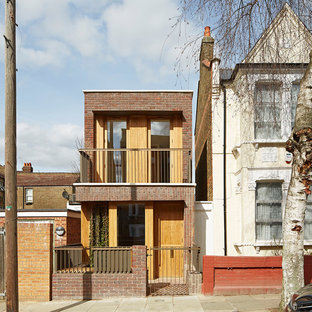 Design ideas for a scandi two floor terraced house in London with a flat roof.