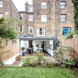 Inspiration for a medium sized contemporary brick exterior in London with three or more floors.
