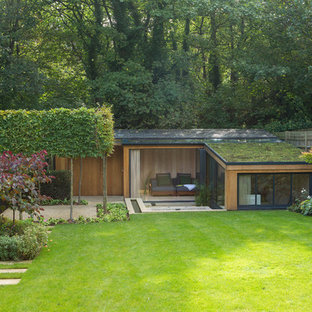 Contemporary exterior in London with a green roof.